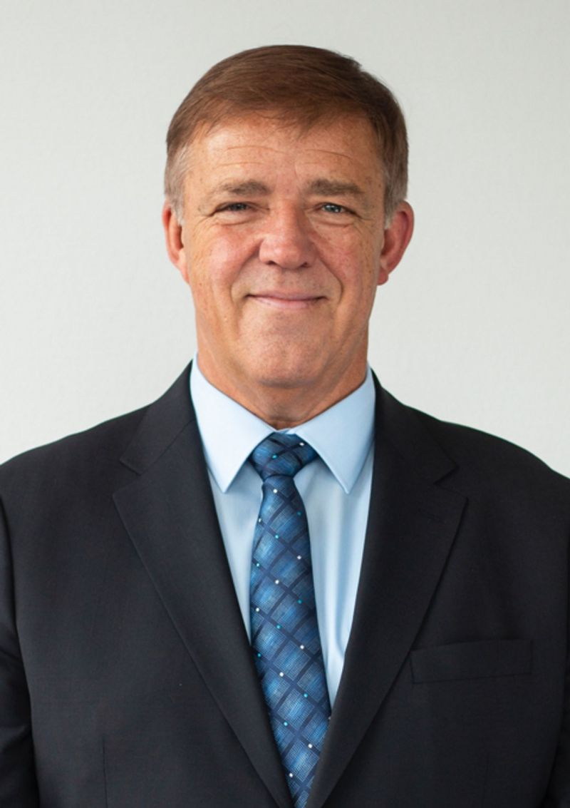 The person depicted is Christian Rehberg – Senior Management